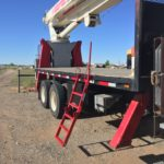 securing loads on a flatbed trailer safely with a flatbed safety ladder