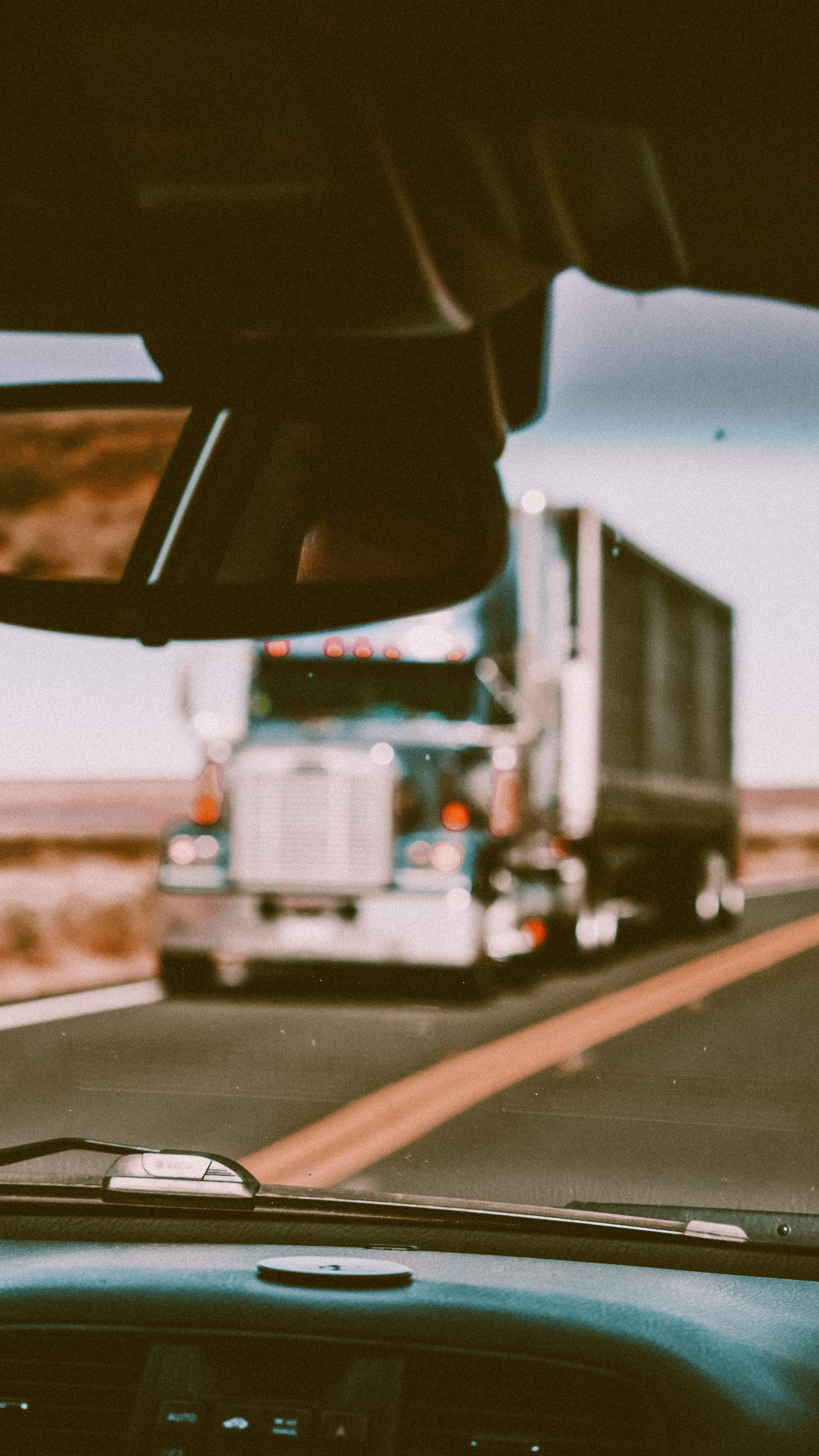 blurry image of truck through another truck window